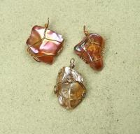 Bergkristall Trommler Anhänger behandelt gefasst Bronzefarben ca. 30 - 45 mm - Einzelset